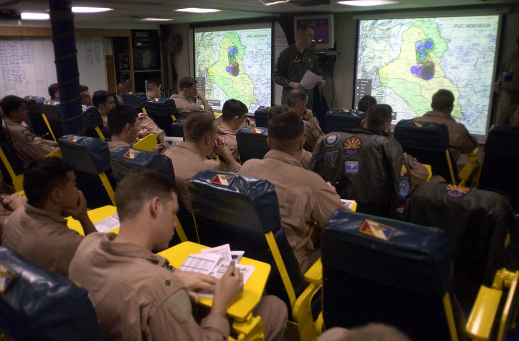 030321-N-4142G-020 Arabian Gulf (Mar. 21, 2003) -- Pilots assigned to Carrier Air Wing Two (CVW-2) listen to a pre-flight brief in one of the squadron ready rooms. Constellation and her embarked CVW-2 are conducting combat missions in support of Operation Iraqi Freedom. U.S. Navy photo by Photographer's Mate 2nd Class Felix Garza Jr. (RELEASED)